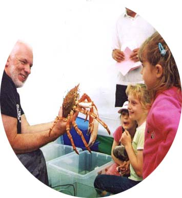 Len Nevell with a Spider Crab, Maja. (Photograph by Duncan Morrison at Adur World Oceans Day 2002)