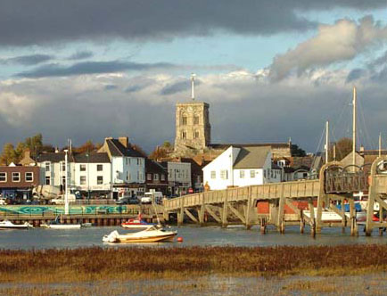Shoreham Town Centre from the south side of the River Adur, featuring the  Church of St. Mary de Haura
