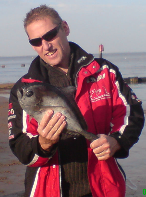 Chris Holden with the Ray's Bream on Cleethorpes beach